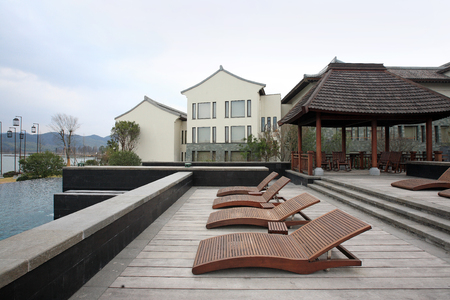 deck chairs: Deck chairs and pavilion by the swimming pool