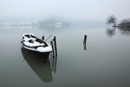 snow capped: A snow capped boat on the lake
