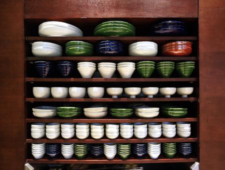rack arrangement: Ceramic bowls and plates on a rack