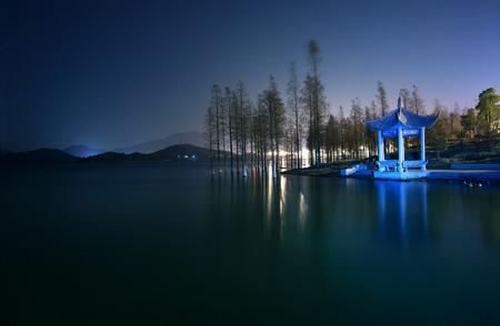 gazebo: A gazebo by the lake at night Stock Photo