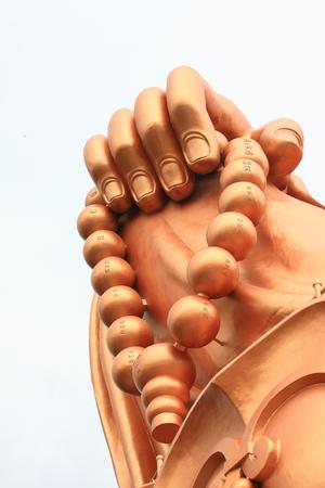 maitreya: Buddhist prayer beads part on The Great Maitreya statue