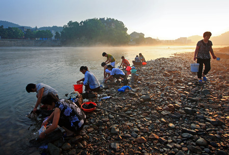 villagers: Villagers washing clothes by the river