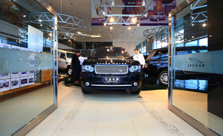 only three people: Entrance of an automobile showroom
