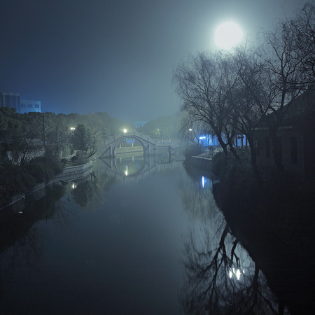 historical reflections: Night view by the river