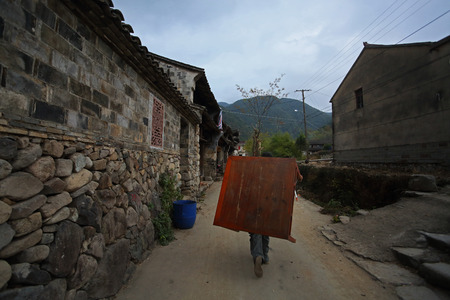 villager: Villager carrying a wooden table