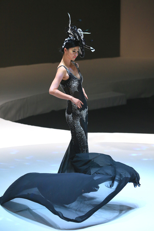 adult mermaid: Model posing on stage