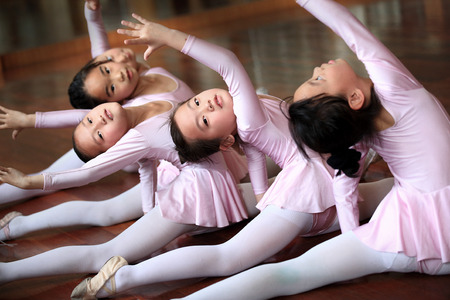 practicing: Girls practicing ballet in classroom