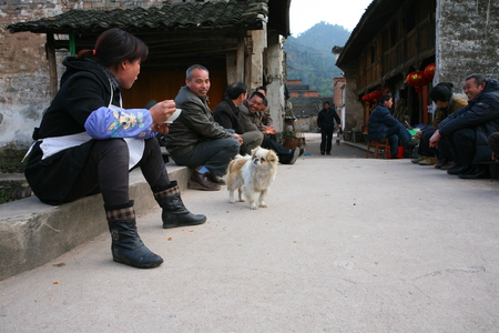 villagers: Villagers sitting on the walkway