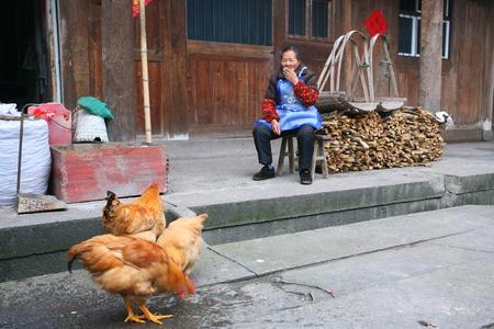 log basket: Old woman sitting and smoking