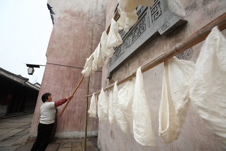 one mature woman only: Woman drying cloths Editorial
