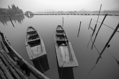 wooden stick: Wooden boats by the dock