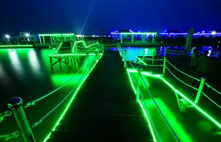 neon lights: Neon lights on the dock Editorial
