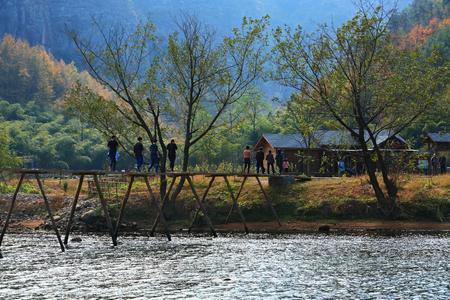 villagers: Villagers walking on the bridge Editorial