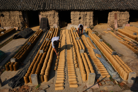 roof tiles: Workers drying roof tiles