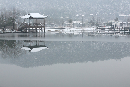 capped: View of Dongqian Lake and snow capped observation deck