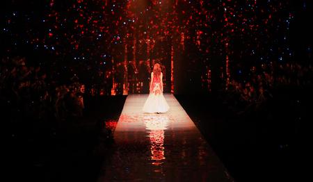 fashion runway: A model walking back in a fashion runway Editorial