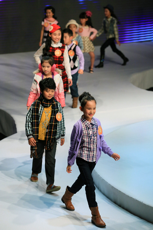 runway fashion: Children walking on fashion runway Editorial