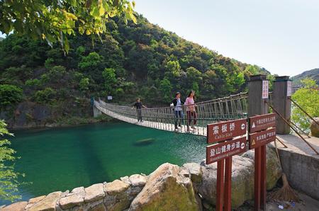 rope bridge: Tourists walking on a rope bridge