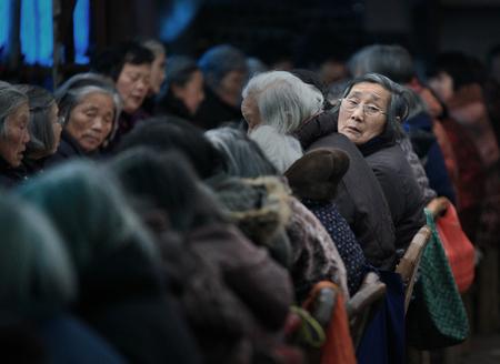 80 plus years: Senior women sitting in rows Editorial
