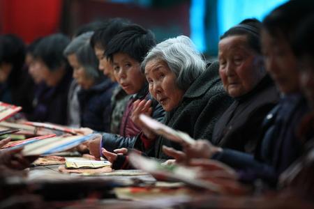 80 plus years: People passing joss paper around Editorial