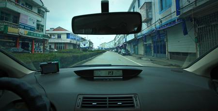 car lots: A car driving through the streets