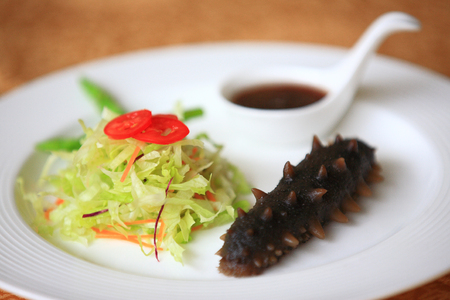 sea cucumber: Sea cucumber dish Stock Photo
