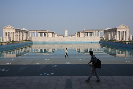 greek temple: View of a pool and replicas of ancient Greek temple Editorial
