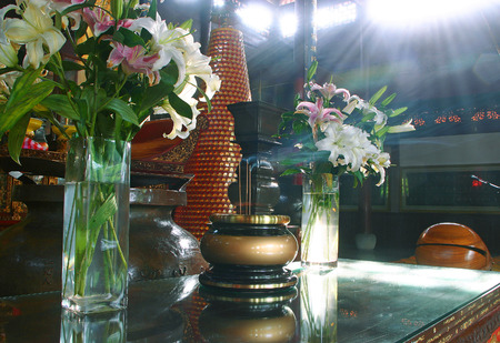 altar: Lily flowers in vase on an altar