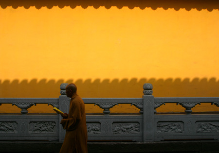 sutra: A monk holding a sutra while walking
