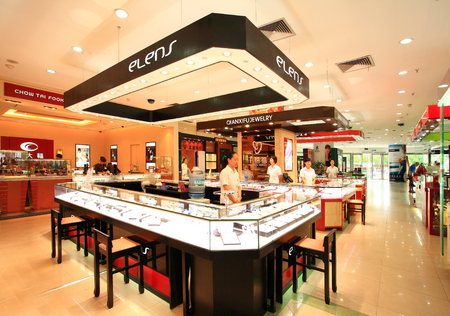 incidental people: View of a jewelry store in the department store Editorial