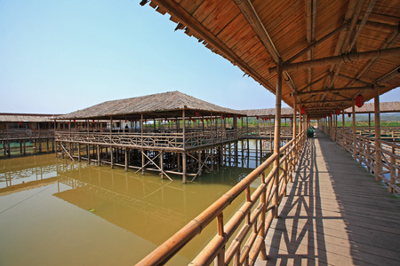sheltered: Sheltered walkway in a fish farm