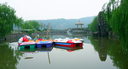 paddle wheel: Paddle boats in a pond Editorial