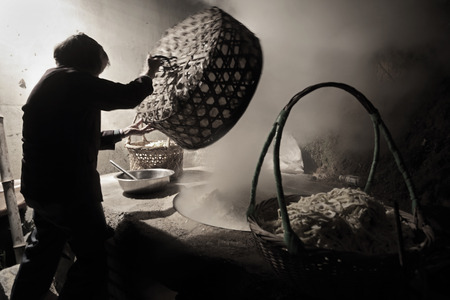 obscured face: A person cooking in old kitchen