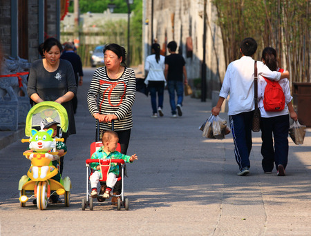 old people: View of people in Nantang Old Street Editorial