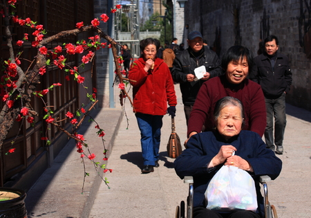 old people: People travelling in the Nantang Old Street Editorial