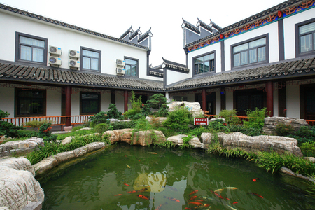 koi fish pond: A koi fish pond in the garden of Wujia Manor Hotel