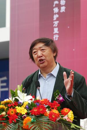 collared shirt: Man giving a speech