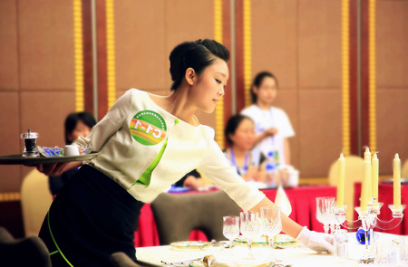 contestant: A contestant setting up the dining table in a competition