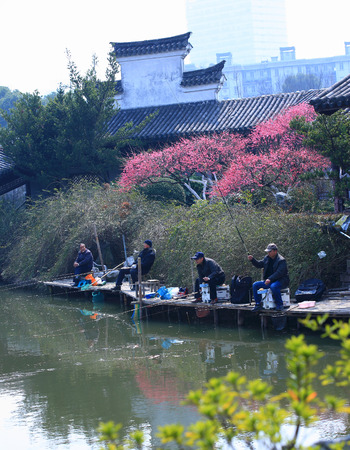 four people: View of four people fishing at the Yuehu Lake, Ningbo Editorial