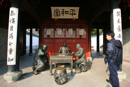 describing: Statues describing the invention of mahjong game