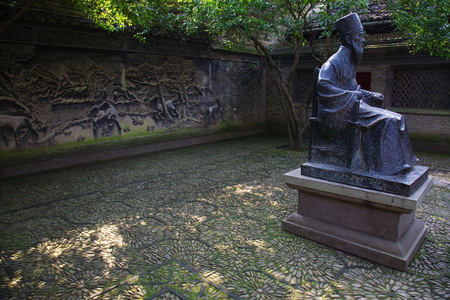 qin: View of statue of Fan Qin and stone carved wall behind in Tian Yi Ge Editorial