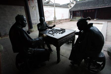 describing: Display of statues describing the invention of mahjong game Editorial
