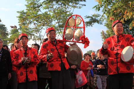 performers: Senior performers playing traditional instruments Editorial