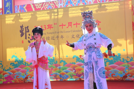 stage actors: Two actors performing Chinese opera on stage Editorial