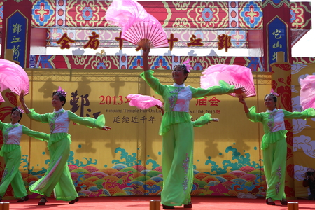 performing: Dancers performing the fan dance on stage