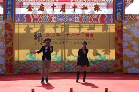 performers: Two performers on stage during the temple festival Editorial