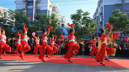 performers: Performers dancing on the streets during temple festival Editorial