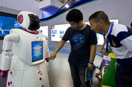 four person only: Men trying out robot functions
