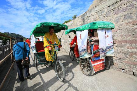 ledge: Trishaws passing through an alley Editorial