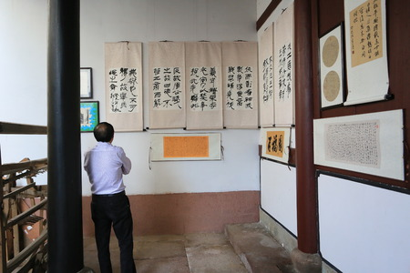 caligraphy: Man looking at chinese caligraphy on display